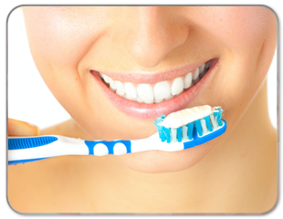 woman smiling with toothbrush