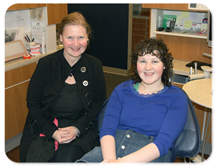 female staff and patient smiling